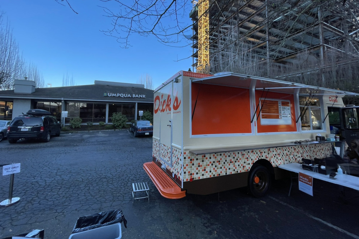 A food truck from Dick's Drive-In parked outside an Umpqua Bank in Bellevue