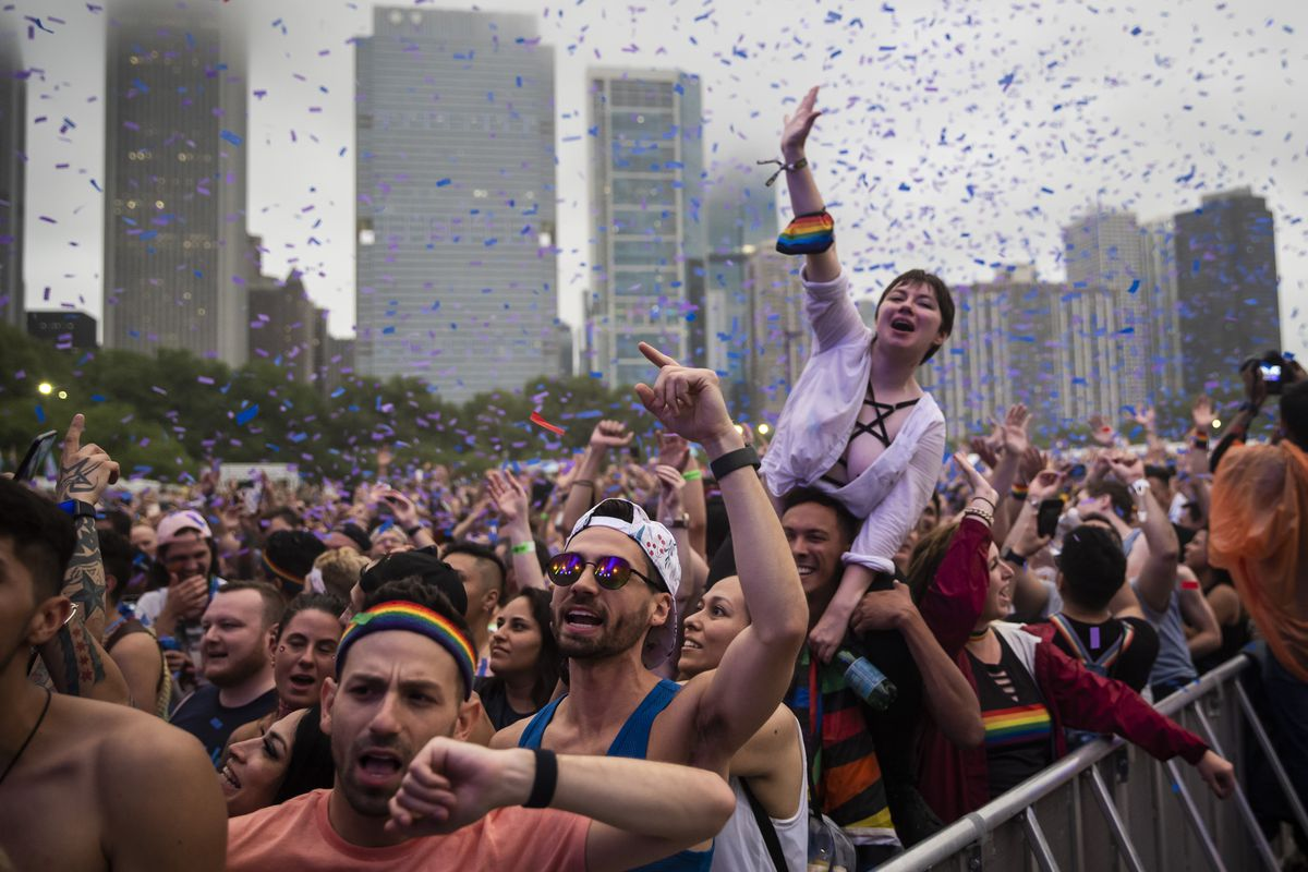Festival-goers dance to Betty Who's performance Saturday night at Pride in the Park in Grant Park.