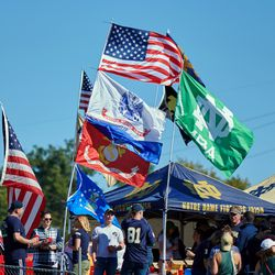 SOUTH BEND, IN - SEPTEMBER 30: A detailed view of several flags are seen being flown by a Notre Dame Fighting Irish tailgate tent prior to the start of the college football game between the Notre Dame Fighting Irish and Miami Redhawks on September 30, 2017, at Notre Dame Stadium in South Bend, IN.