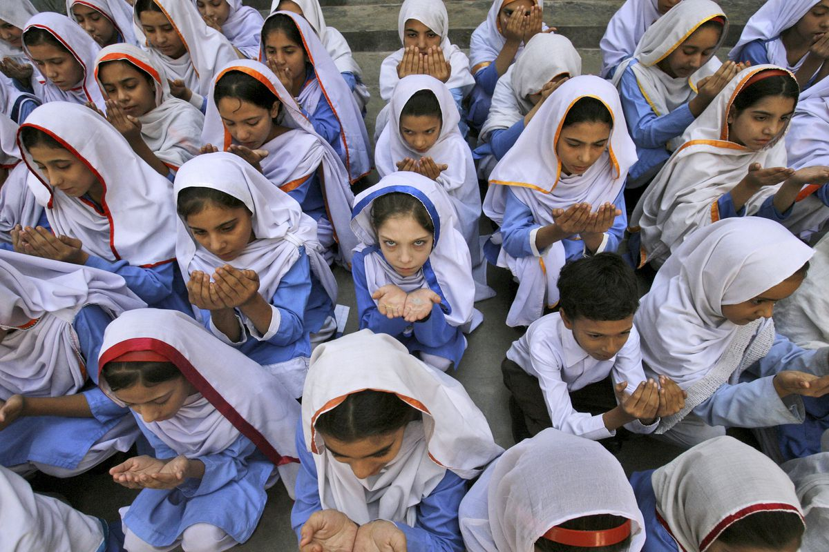 Pakistani students pray for the recovery of 14-year-old schoolgirl Malala Yousufzai, who was shot by the Taliban for speaking out in support of education for women, in Peshawar, Pakistan, 2012.