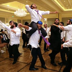 Men dance at Chaya Zippel and Rabbi Mendy Cohen's traditional Hasidic wedding at the Grand America Hotel in Salt Lake City on Monday, Sept. 12, 2016.