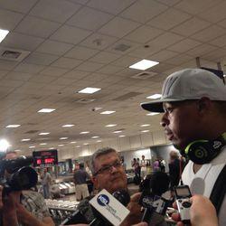 New Utah Jazz player Randy Foye is met by local reporters at Salt Lake International Airport, July 25, 2012.