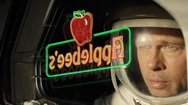 brad pitt with the applebee's logo reflected over his face
