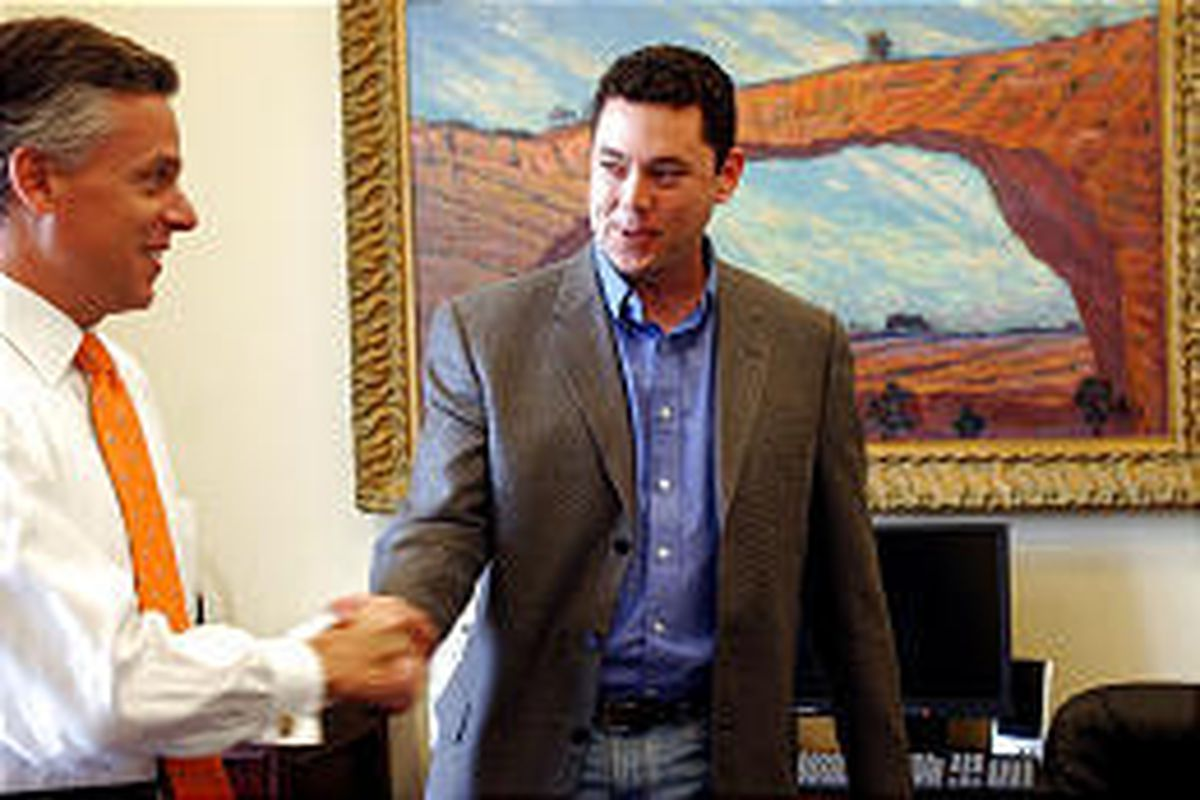 Gov. Jon Huntsman Jr. visits with chief of staff Jason Chaffetz in Chaffetz's office the day before the aide stepped down.