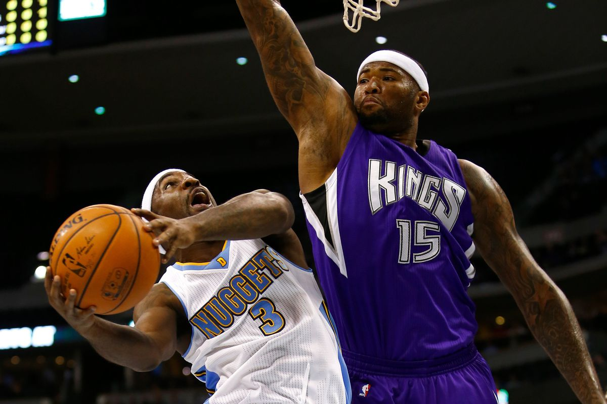 Ty Lawson drives into DeMarcus Cousins on his way to the hoop.