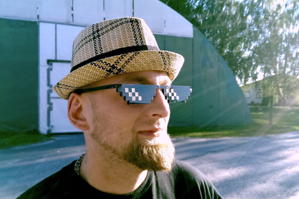 A man models the new 'Deal with It' sunglasses