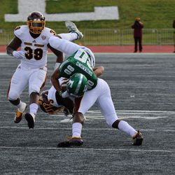 Dylan Drummond as he gets tackled after a pass.