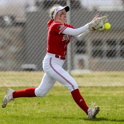 Bountiful center fielder Amy Black can't make a running catch of a fly ball during a game against Clearfield at Millcreek Junior High School in Bountiful on Wednesday, March 24, 2021.