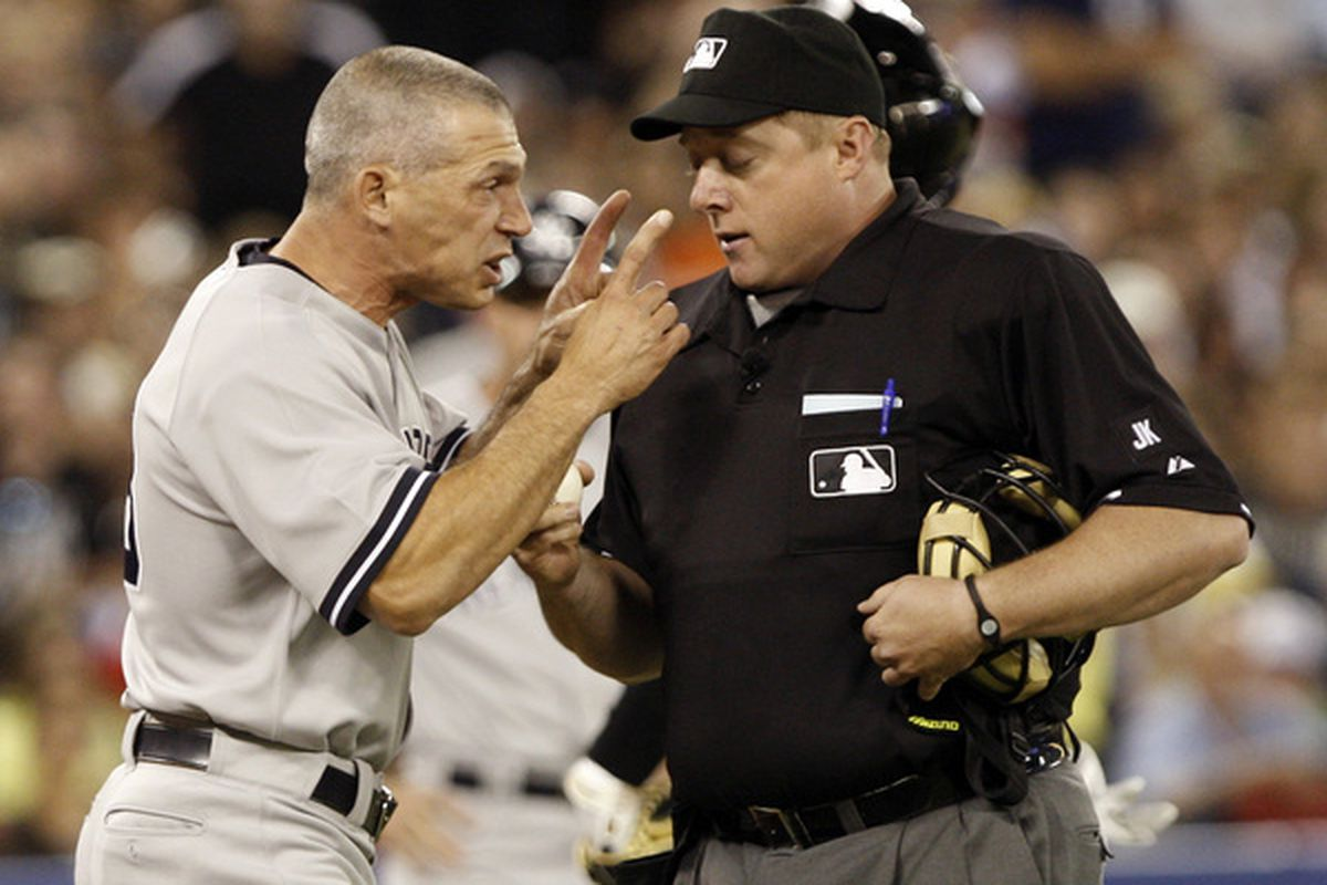 TORONTO - JUNE 6: Manager Joe Girardi of the New York Yankees yells at Umpire Bruce Dreckman at the Rogers Centre June 6, 2010 in Toronto, Ontario, Canada. Girardi was ejected from the game (Photo by Abelimages/Getty Images)