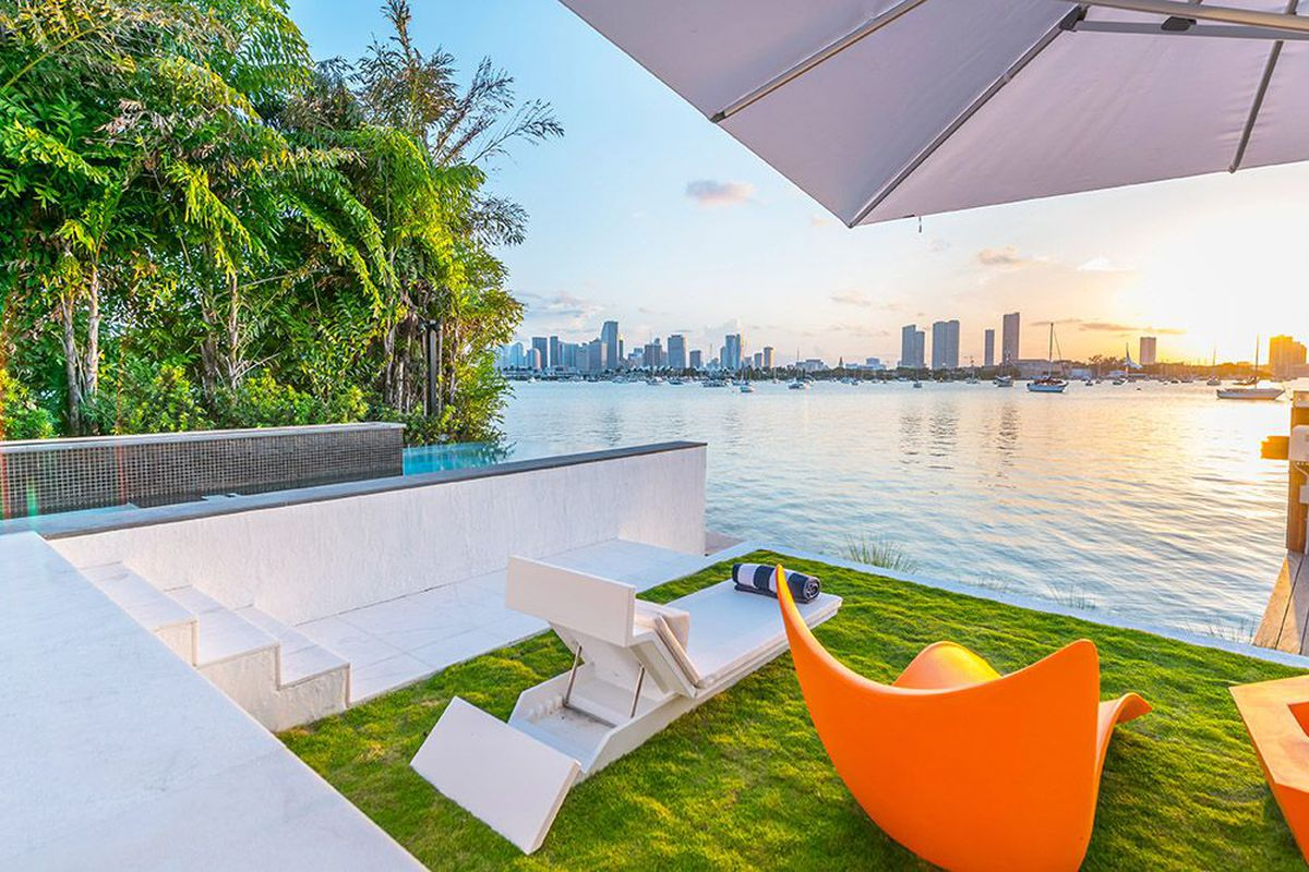 a gorgeous view from a waterfront home on miami beach as the suns sets