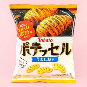 A black and white package with Japanese lettering showing potato snacks.