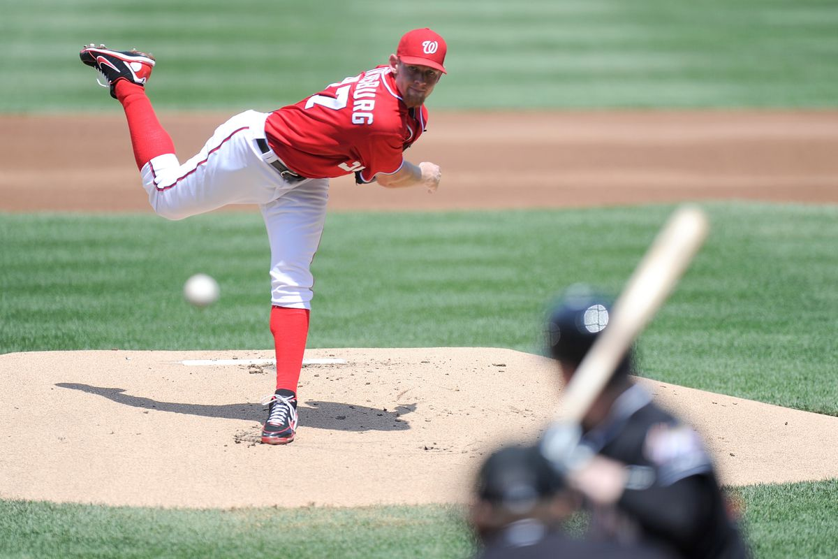WASHINGTON, DC - AUGUST 05:  Stephen Strasburg #37 of the Washington Nationals pitches against the Miami Marlins at Nationals Park on August 5, 2012 in Washington, DC.  (Photo by Greg Fiume/Getty Images)