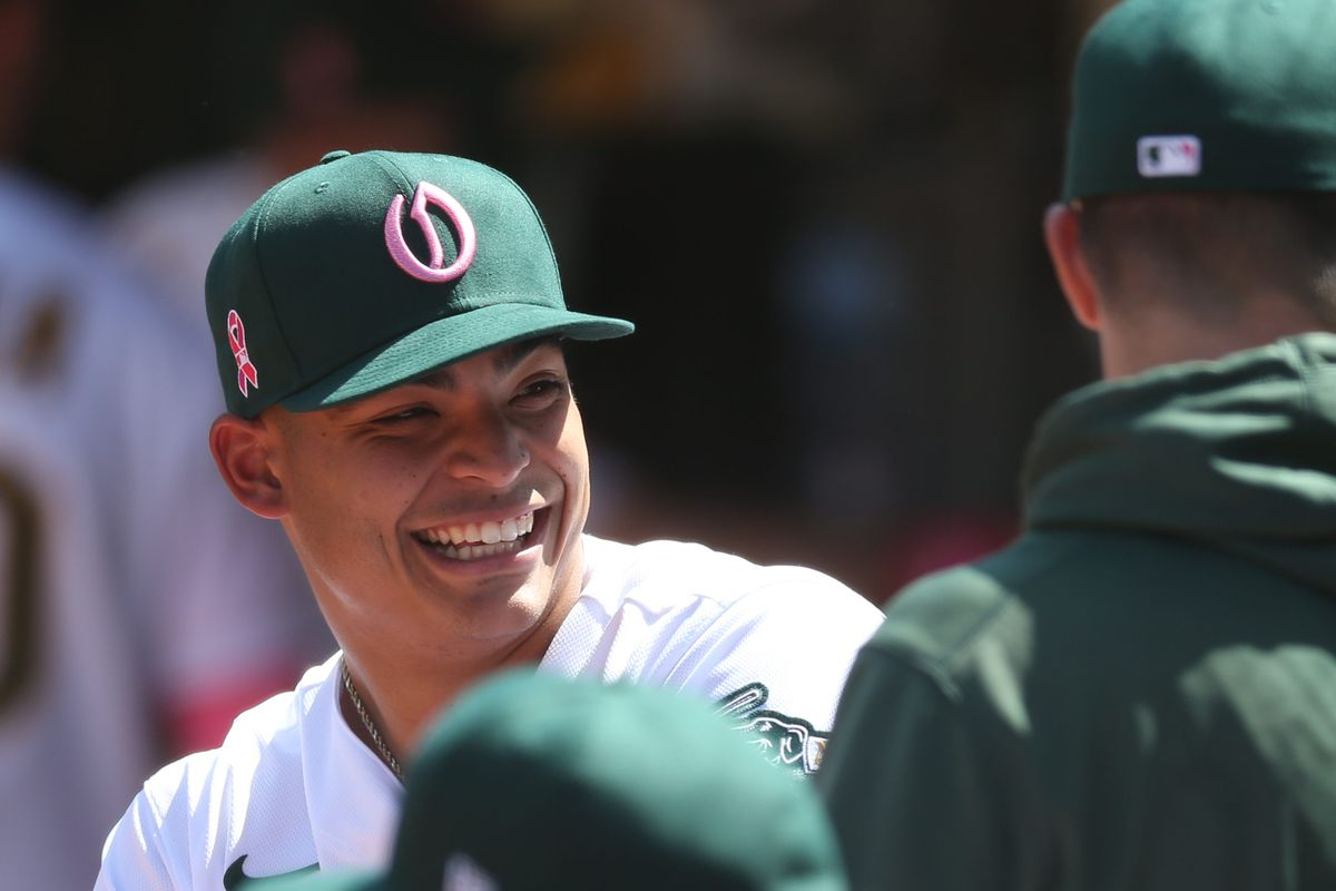Jesus Luzardo (44) smiling in dugout with teammates during game vs Tampa Bay Rays at RingCentral Coliseum