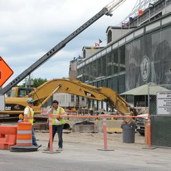 11:11 a.m. Work in progress, on the Clark Street side of the triangle lot -