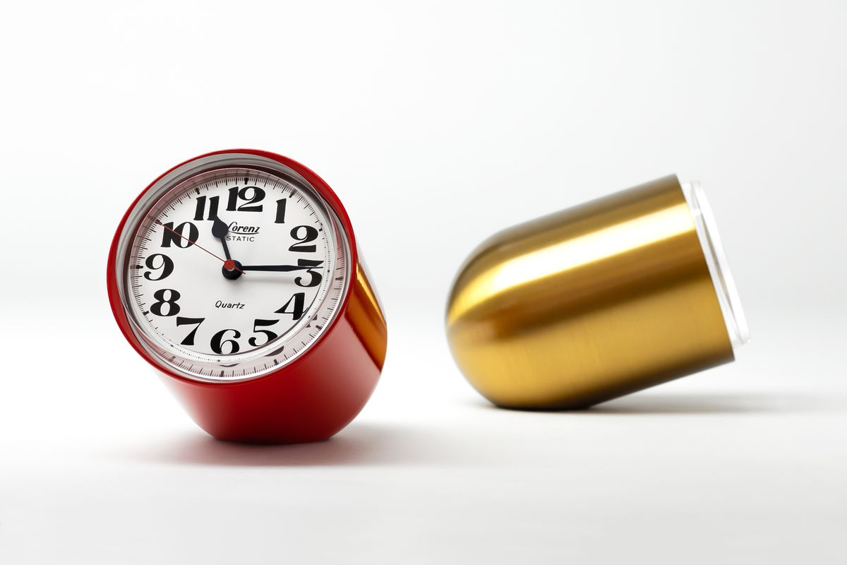 One red clock and one gold clock.