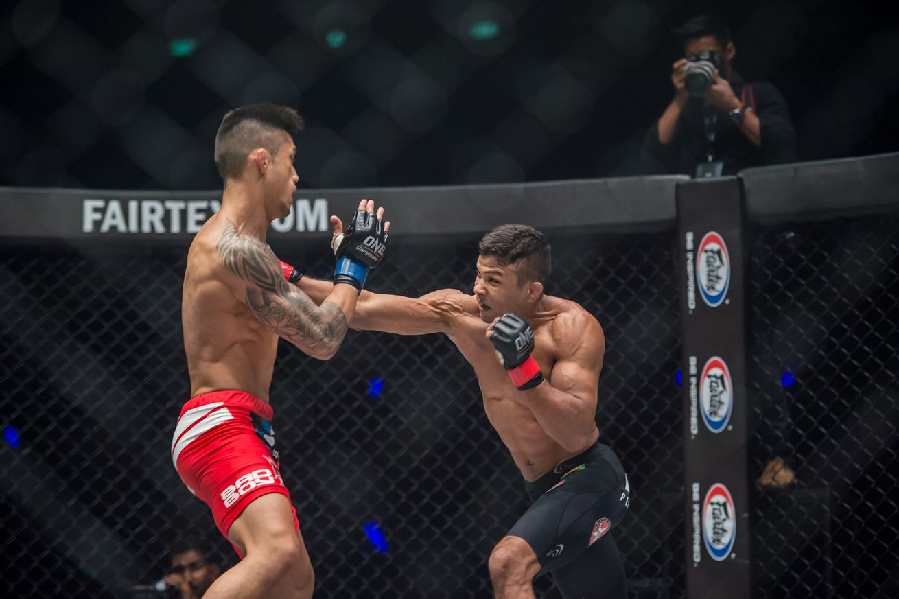 Bibiano Fernandes (right) throws a punch in the main event of ONE Championship: Iron Will in Bangkok, Thailand, on Saturday.