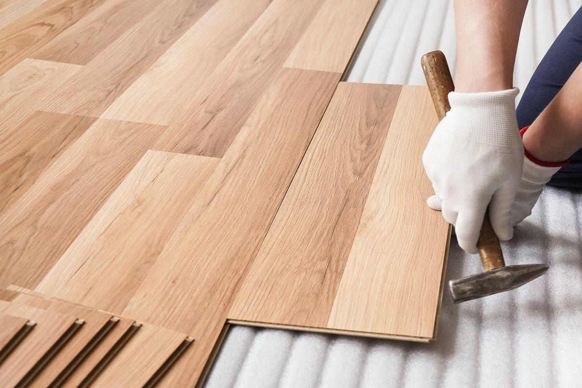 Installing wood flooring.