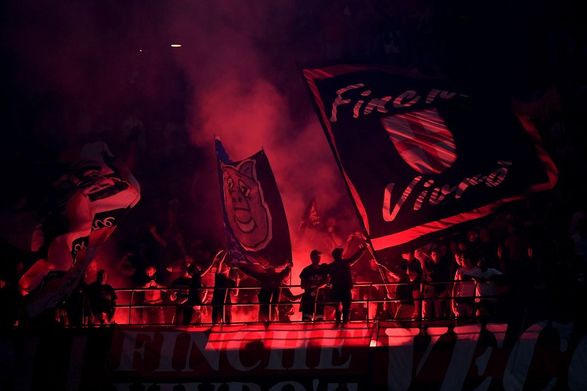AC Milan fans light flares during the Serie A football match...