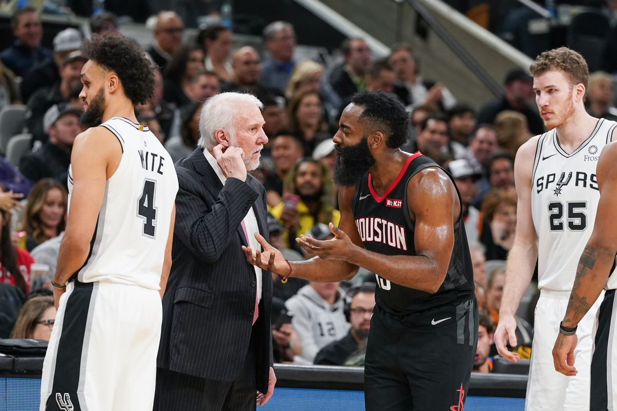 Houston Rockets guard James Harden talks with San Antonio Spurs head coach Gregg Popovich over a disputed basket in the second half at the AT&T Center.