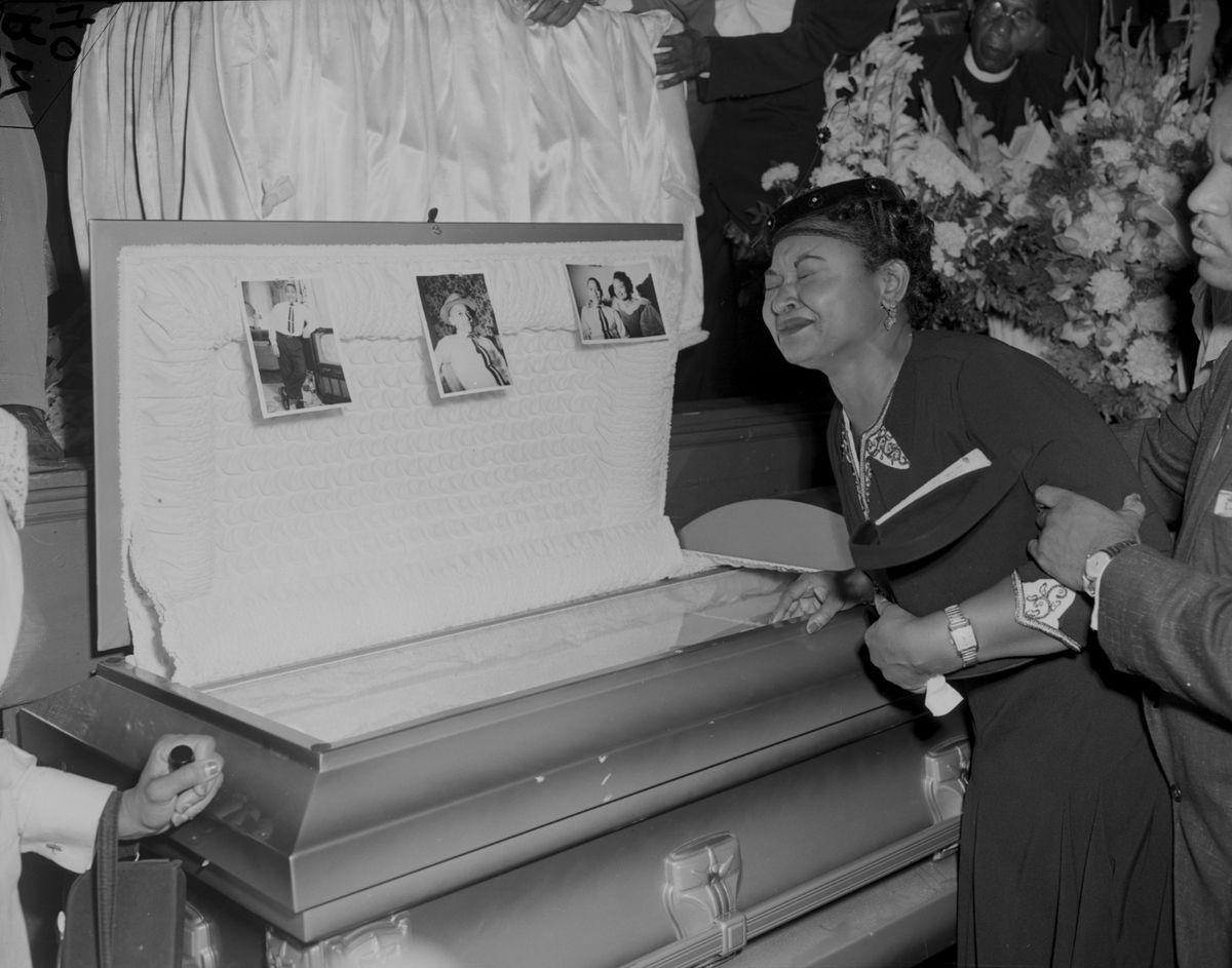 Funeral for Emmett Till. Mother of Emmett Till, Mamie Mobley pauses at the casket at A.A.Rayner funeral home.