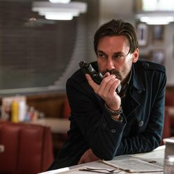 """Buddy (Jon Hamm) waits for Baby in the diner in """"Baby Driver."""""""