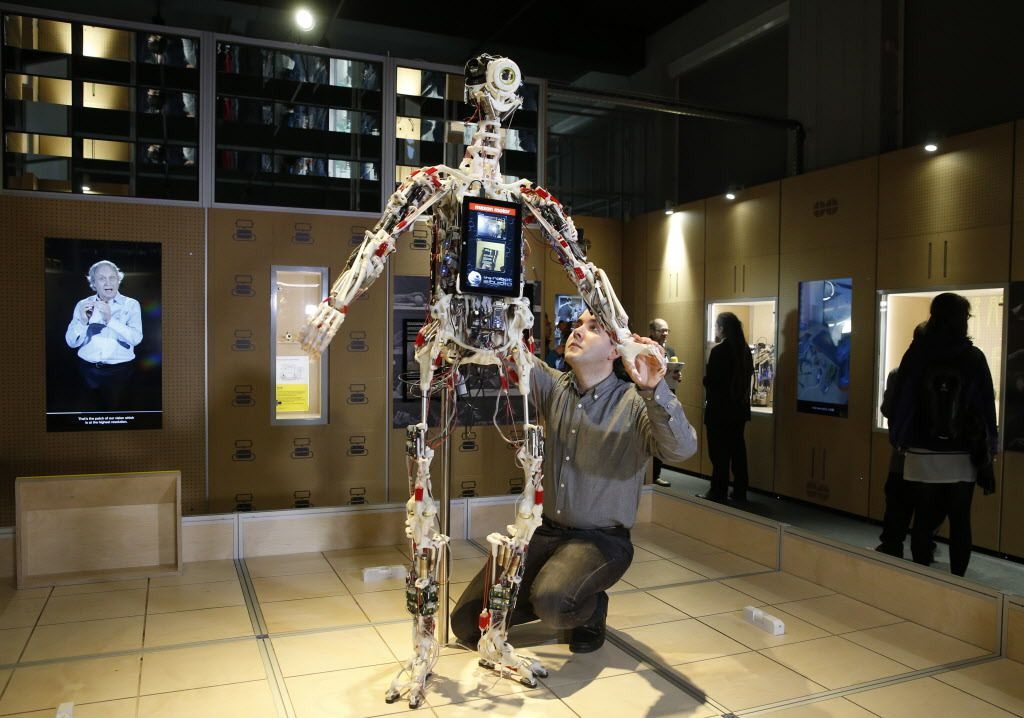 A technician adjusts Rob's Open Source Android (ROSAL) which was built in France from 2010-2016, at the Science Museum in London, Tuesday, Feb. 7, 2017. The exhibition shows 500 years of mechanical and robotic advances.(AP Photo/Alastair Grant)