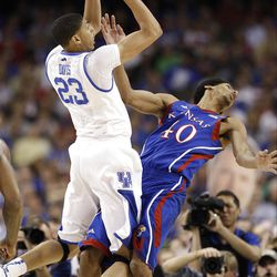 Kentucky's Anthony Davis (23) shoots over Kansas' Kevin Young (40) during the first half of the NCAA Final Four tournament college basketball championship game Monday, April 2, 2012, in New Orleans. (AP Photo/David J. Phillip)