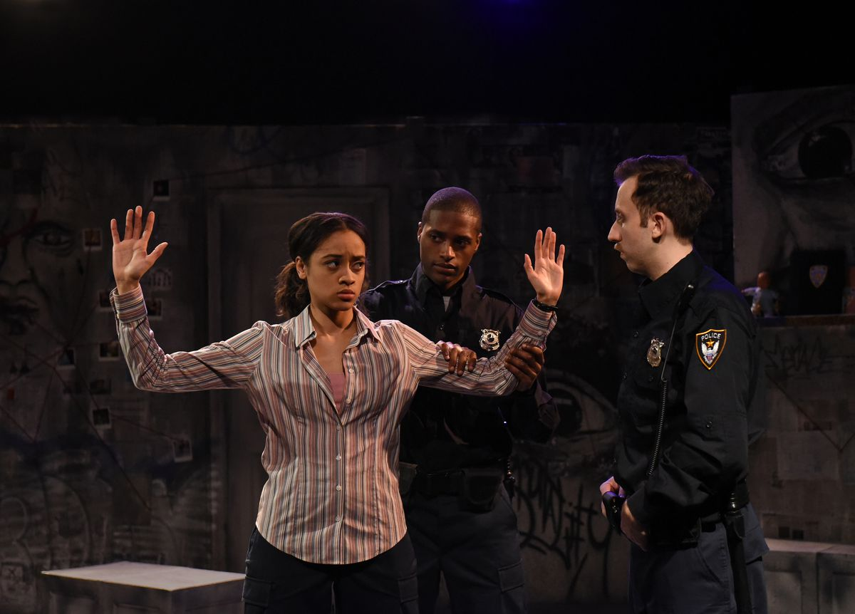 """Mrai (LaNora Terrae Hayden) is arrested by Dece (Maurice Demus) and Flip (Anthony Venturini) in Eclipse Theatre's production of """"Force Continuum"""" by Kia Corthron. (Photo: Scott Dray)"""