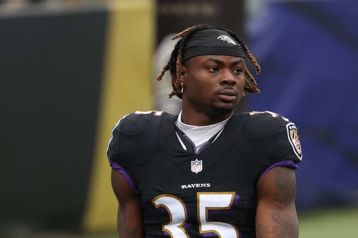 Running back Gus Edwards #35 of the Baltimore Ravens looks on before playing against the Tennessee Titans at M&T Bank Stadium on November 22, 2020 in Baltimore, Maryland.
