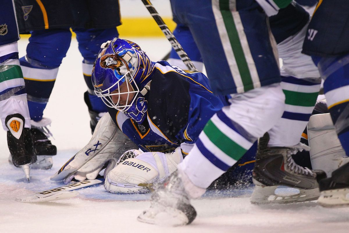 ST. LOUIS, MO - NOVEMBER 4: Brian Elliott #1 of the St. Louis Blues falls on the puck to make a save against the Vancouver Canucks at the Scottrade Center  on November 4, 2011 in St. Louis, Missouri.  (Photo by Dilip Vishwanat/Getty Images)