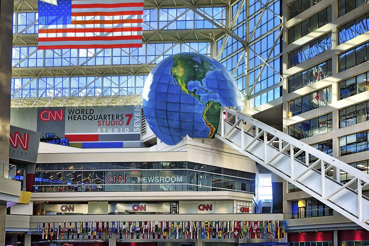CNN's headquarters in Atlanta, Georgia, featuring a large flag and a large globe