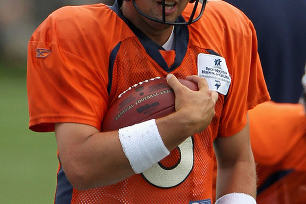 ENGLEWOOD CO - AUGUST 05:  Quarterback Kyle Orton #8 of the Denver Bronocs takes part in practice during training camp at Dove Valley on August 5 2010 in Englewood Colorado.  (Photo by Doug Pensinger/Getty Images)
