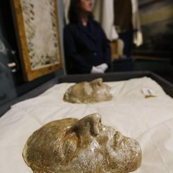 The death masks of Joseph and Hyrum Smith are taken down at the Church History Museum in Salt Lake City Wednesday, Sept. 24, 2014. Thirty years after its original opening, the Church History Museum will close on October 6, 2014, for one year to complete major renovations. The museum will reopen in fall 2015 with a newly designed floor plan and exhibitions.