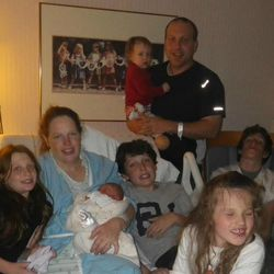 Tyler and Katie Groves are shown with their six children following the birth of their newest addition four months ago.