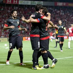 Atletico Madrid's players celebrate a goal against Hapoel Tel Aviv during the Europa League Group B soccer match at the Bloomfield stadium in Tel Aviv, Israel,Thursday, Sept. 20, 2012.