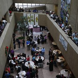 Couples get married in the atrium at the Salt Lake County clerk's office, Monday, Dec. 23, 2013, while other couples wait on the sides to get marriage licenses.