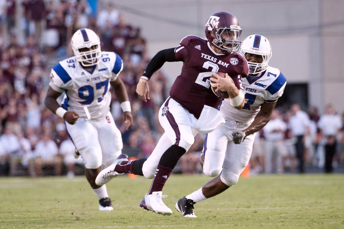Sep 22, 2012; College Station, TX, USA; Texas A&M Aggies quarterback Johnny Manziel (2) runs for a touchdown against the South Carolina State Bulldogs during the first half at Kyle Field. Mandatory Credit: Brendan Maloney-US PRESSWIRE