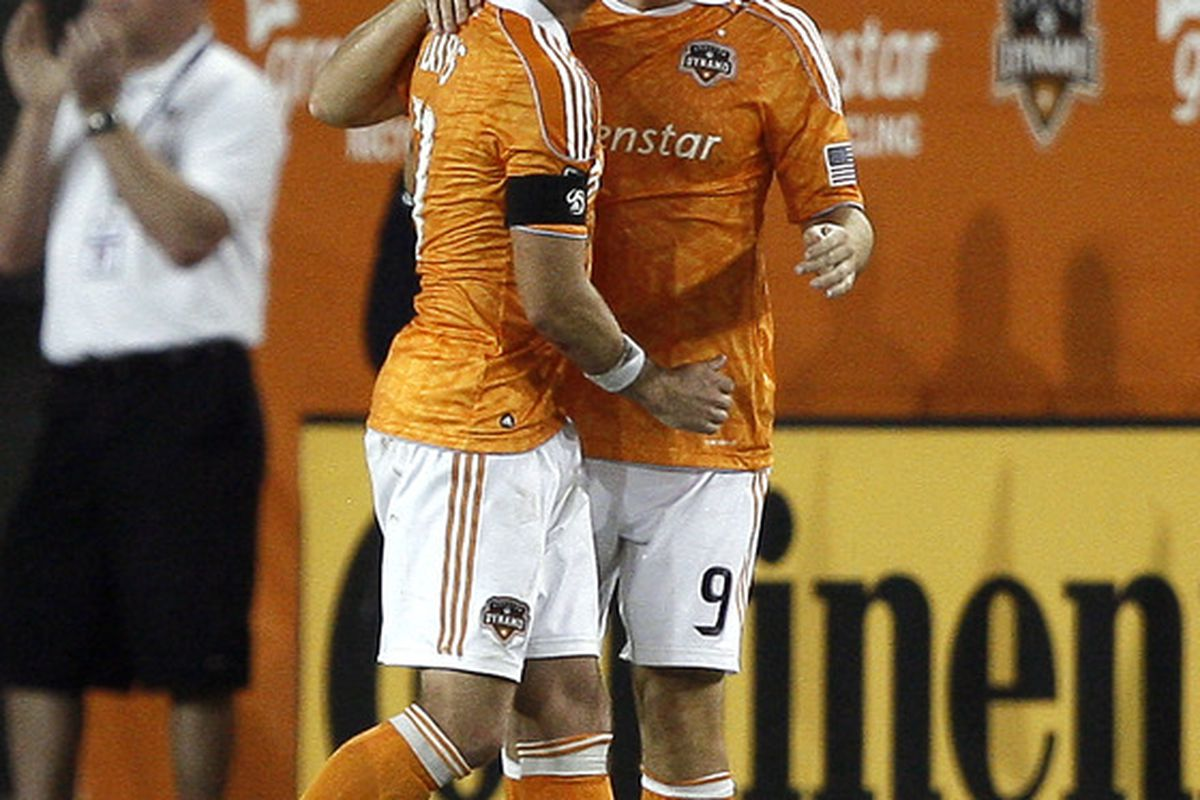 HOUSTON - SEPTEMBER 04:  Jason Garey #9 of the Houston Dynamo is congratulated by Brad Davis #11 after scoring in the second half against Monterrey at Robertson Stadium on September 4, 2011 in Houston, Texas.  (Photo by Bob Levey/Getty Images)