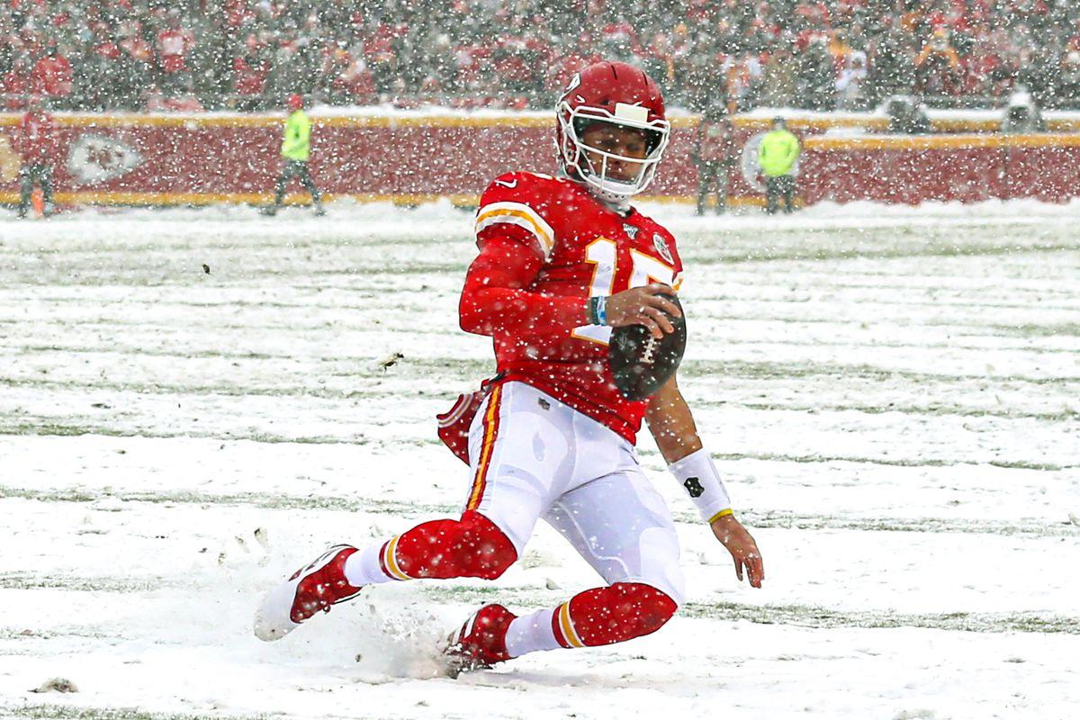 Kansas City Chiefs quarterback Patrick Mahomes slides against the Denver Broncos during the first half at Arrowhead Stadium.