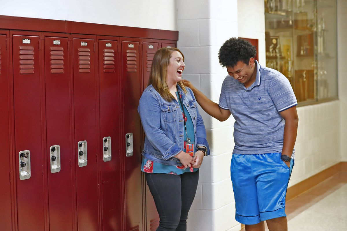 Jessika Osborne, ESL coordinator and Title 3 Coordinator for Manual High School, left, talks with Lester at Emmerich Manual High School, Monday, July 31, 2018. Lester moved to Indianapolis when he was 15 years old and is set to graduate from Manual in 2019.  Lester, an undocumented immigrant from Honduras, dreams of going to college.  He hopes that football will help him pay for that dream.