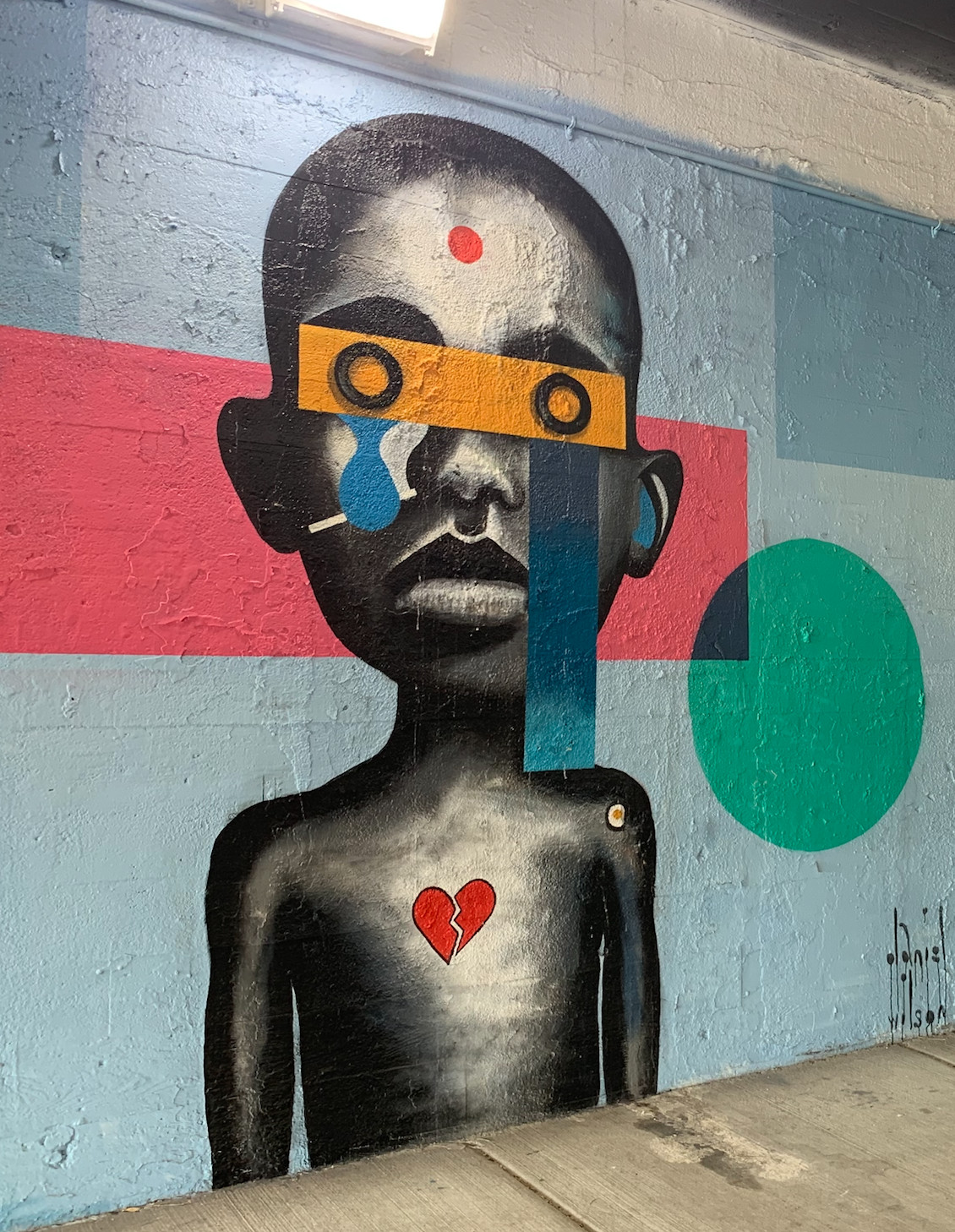 """Daniel Wilson says this mural is """"based on a canvas that I did. I was doing a portrait and didn't like the eyes."""" So he decided to obscure them. He's from Britain, lives in Humboldt Park and works in Pilsen."""