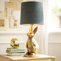 Bunnies, not just for delivering candy-filled baskets. The Emily + Meritt Brass Bunny Table Lamp, $119, next to the Wish Box, $59.