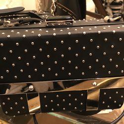 Alexander McQueen clutch, $780