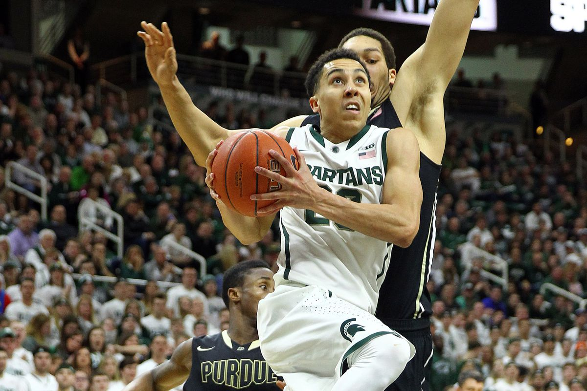 Travis Trice goes in for a layup against Purdue's AJ Hammons.