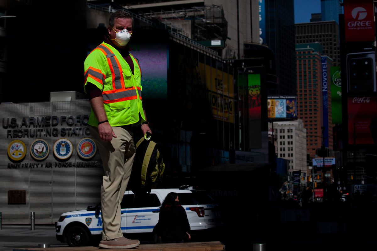Construction waste recycling worker Sean Ragiel takes a break in Times Square after working at a job site.