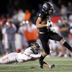 Corner Canyon's Blaze DeGracie high kicks out of a tackle attempt by Skyridge's Dalton Young during a high school football game at Corner Canyon in Draper on Friday, Sept. 24, 2021. Corner Canyon won 38-23.