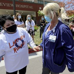Ana Lucio, who was fighting COVID-19 on a ventilator this time last year, catches up with registered nurse Lisa Whittaker, who took care of Lucio in the Lakeview Hospital intensive care unit, after an Alex Boyé concert outside of the Bountiful hospital on Tuesday, May 4, 2021. Lucio was in the hospital for more than two months and was Lakeview's longest COVID-19 admission. She was discharged in May 2020.