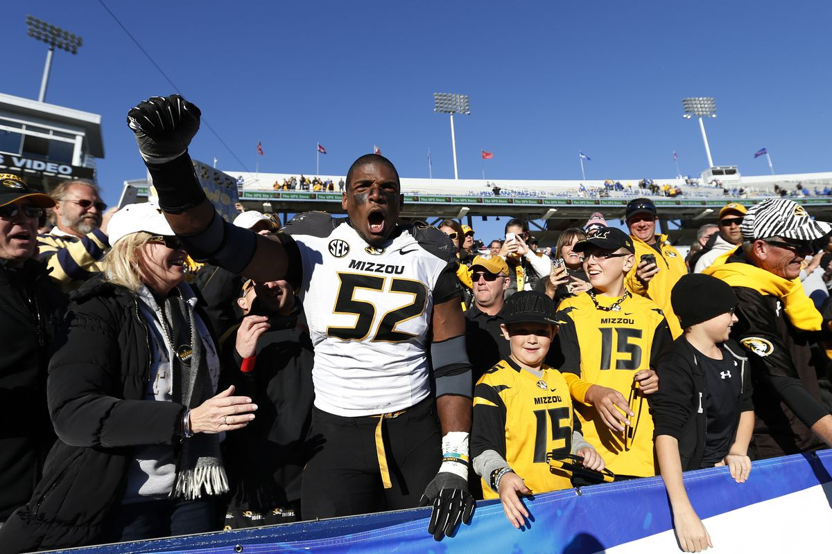 Michael Sam celebrates with Missouri fans after a 2013 victory over Kentucky