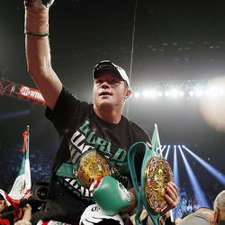 Canelo Alvarez, of Mexico, celebrates defeating Josesito Lopez following their super welterweight championship boxing match on Saturday, Sept. 15, 2012, in Las Vegas.