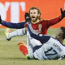 Real's Kyle Beckerman tries to get a foul called on Kansas City's C.J. Sapong as Real Salt Lake and Sporting KC play Saturday, Dec. 7, 2013 in MLS Cup action. Sporting KC won in a shootout.